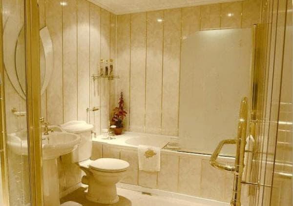 стеновые панели из пвх для ванной в золотом цвете